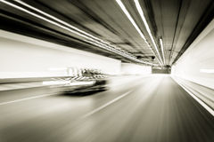 Abstract speed motion in highway road tunnel, blurred motion tow Royalty Free Stock Photography