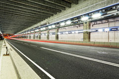 Abstract speed motion in urban highway road tunnel, blurred moti Royalty Free Stock Image