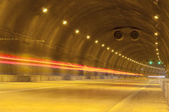 Abstract speed motion in urban highway road tunnel Stock Images