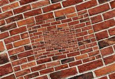 Abstract spiral abstract effect red brick wall texture background pattern. Arch arc mosaic bricks wall Red bricks wall spiral mosa Royalty Free Stock Photo