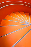 Abstract spiral orange staircase background. Top view Stock Photo
