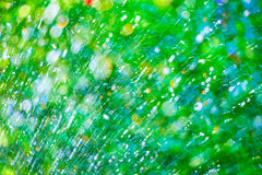 Abstract splashes and drop on natural fresh blur background Stock Image