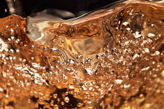 Abstract splashes of white wine on a black background Stock Photo