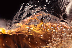 Abstract splashes of white wine on a black background Royalty Free Stock Image