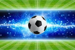 Soccer ball, powerful bright blue lightning, green soccer fields Stock Images