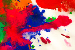 abstract spots splash of bright colors on white paper macro Stock Photo