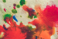 Abstract spots splash of bright colors on white paper macro Stock Photos