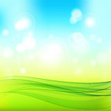 Abstract spring background. Blue-green background with bright patches of sunlight and abstract transparent wave Stock Images