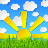 Abstract spring background with green grass, sun and blue sky wi Royalty Free Stock Images