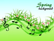 Abstract spring background with music notes and a treble clef. On a flower meadow Stock Images