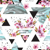 Abstract spring geometric seamless pattern. Triangles with watercolor cherry tree blossom, flowers, marble, grunge texture. Water color background with stock illustration