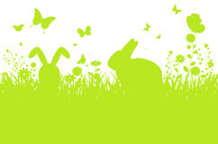 Abstract spring meadow silhouette with bunnies, flowers and butt Royalty Free Stock Images