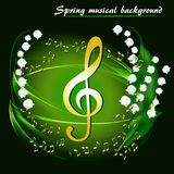 Abstract spring musical background with lily of the valley. And golden treble clef on a black background Royalty Free Stock Images