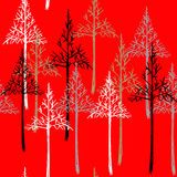 Abstract spruce tree forest background. Christmas seamless pattern on red background. Royalty Free Stock Image