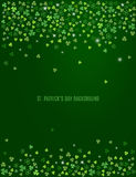 Abstract St. Patrick`s day background with sparkling clover shamrock leaves. Vector. Sparkling clover shamrock leaves isolated on dark green background. Abstract vector illustration