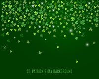 Abstract St. Patrick`s day background with sparkling clover shamrock leaves. Vector Royalty Free Stock Image