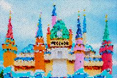 Abstract stained glass image of colorful cartoon colorful castle with blue sky. Abstract stained glass image of colorful cartoon colorful castle with blue sky Stock Illustration