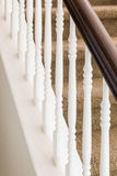 Abstract of Stair Railing and Carpeted Steps in House Stock Image