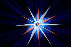 Abstract star among beaming rays. Abstract star among beaming blue rays on black background Stock Image