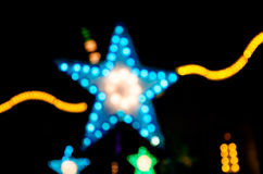 Abstract star shape bokeh light night background. Royalty Free Stock Image