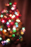 Abstract stars bokeh. Abstract star shaped bokeh in the dark Stock Photo