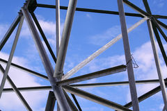 Abstract steel construction. With blue sky and clouds Royalty Free Stock Photos