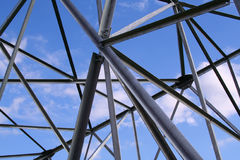 Abstract steel construction. With blue sky and clouds Stock Photo