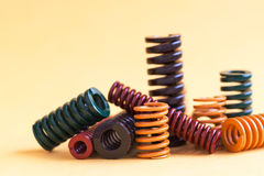 Abstract steel spiral coil springs collection set. Different hardness flexibility size colorful objects. Abstract steel spiral coil springs collection set Stock Image