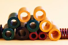 Abstract steel spiral coil springs collection set. Different hardness flexibility size colorful objects.  Stock Photos