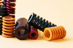 Abstract steel spiral coil springs collection set. Different hardness flexibility size colorful objects.  Stock Images