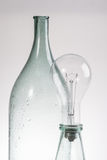 Abstract still life clear glass vintage bottle and lamp Royalty Free Stock Photo