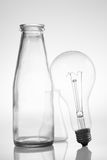 Abstract still life with clear glass vintage bottles and electric lamp. Abstract photo still life clear glass design vintage bottles and electric lamp Stock Photography