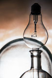 Abstract still life of empty laboratory glass vessels and lightbulb Royalty Free Stock Images