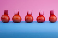 Abstract still life with tomatoes and forks Stock Photography