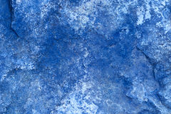 Abstract Stone Background In Blue/ Close Up. Abstract textured stone background. Really great for grunge backgrounds.  Focus is on the center of the picture Stock Image