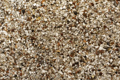 Abstract stone background texture. Abstract background stone texture. This is a selection of small light and dark colored stones. The colors are white, brown stock photography