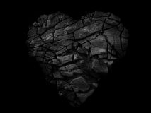 Abstract Stone heart. Isolated on black background Stock Image
