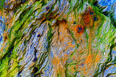 Abstract stone textures. Details of a naturally formed colorful rock with shapes and textures Stock Photos