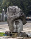 Abstract Stone turtle sculpture on display along a busy street in Hue, Vietnam. Pictured is an abstract stone turtle sculpture on display along a busy street in royalty free stock image
