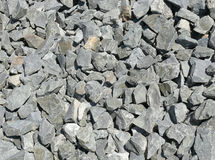 Abstract stony background. Closeup abstract of a background of small light stones Stock Image