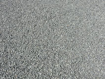 Abstract stony background. Closeup abstract of a background of small light grey stones Royalty Free Stock Photo