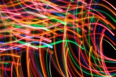 Abstract streaming lights. Colorful light filaments that look like they are in motion. Neon disco type stock photo