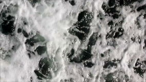 Abstract streaming vertical flow. Turbulent water flows by in a vertical direction stock footage