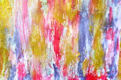 Abstract streams of paints on the wall stock photo