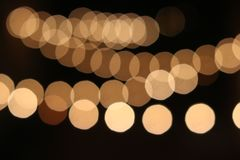 Abstract string of warm white party lights stock image
