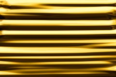 Abstract striped background of gold foil. Royalty Free Stock Photo