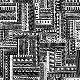 Abstract striped textured geometric tribal seamless pattern. Vector black and white background. Endless texture can be used for wa Stock Images