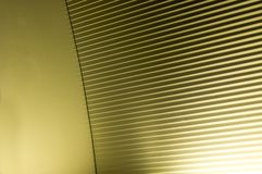 Abstract stripes. You never gonna guess... It's a closeup of a modern wall mounted light source. The stripes form a kind of diffuser for the light which comes Royalty Free Stock Images