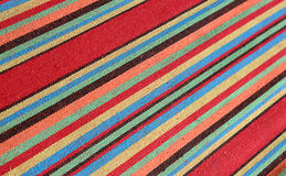 Abstract stripey background. Colorful vintage Mexican textile background with diagonal stripey pattern stock photos