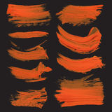 Abstract strokes drawn thick orange paint on black pap Royalty Free Stock Photo